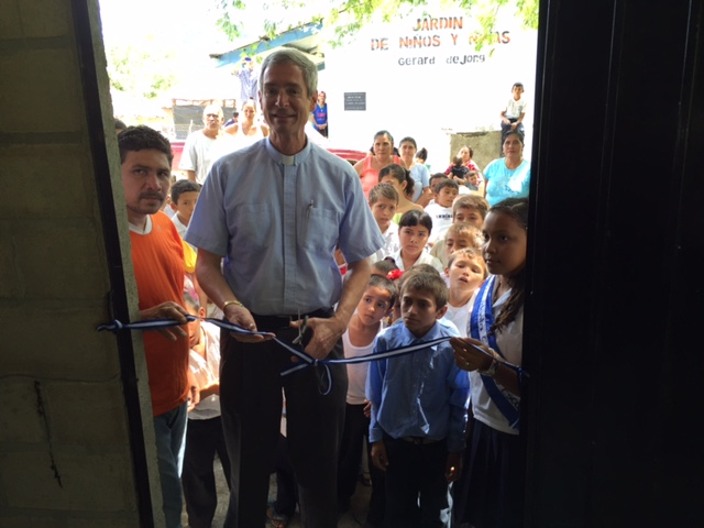 Cutting the ribbon on the new kitchen, built with donations from Messiah Lutheran Church in coordination with Lunches for Learning.