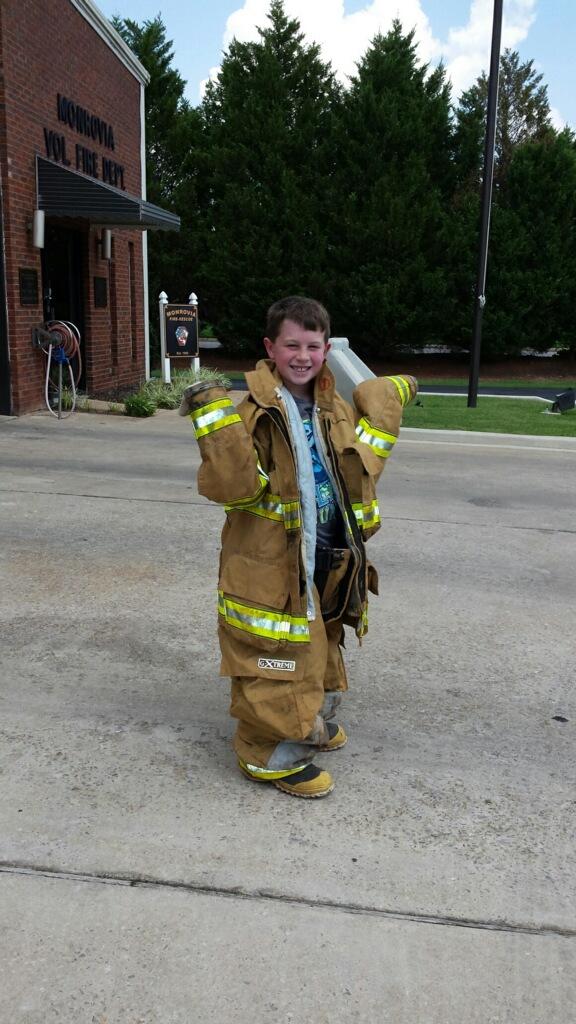 boy in fire gear